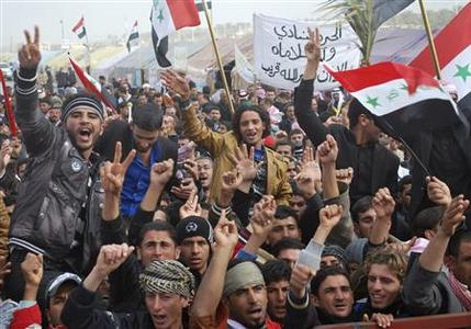 Protesters take part in a demonstration in Ramadi, 100 km (62 miles) west of Baghdad, January 9, 2013. REUTERS/Ali al-Mashhadani