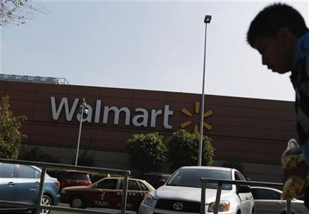 A person walks outside a Wal-Mart store in Mexico City December 18, 2012. REUTERS/Tomas Bravo