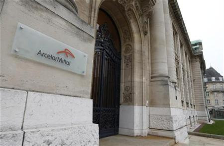 The logo of ArcelorMittal company is seen at the entrance of its headquarters in Luxembourg in this picture taken on November 20, 2012. REUTERS/Francois Lenoir (LUXEMBOURG - Tags: BUSINESS POLITICS) Picture taken on November 20, 2012.