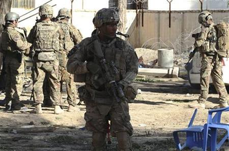 U.S. troops arrive at the site of a suicide attack in Spin Boldak district of Kandahar province January 6, 2013. REUTERS/Ahmad Nadeem (AFGHANISTAN - Tags: CIVIL UNREST MILITARY)