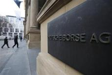 The plaque of the Deutsche Boerse AG is pictured at the entrance of the Frankfurt stock exchange February 1, 2012. REUTERS/Alex Domanski (GERMANY - Tags: BUSINESS)