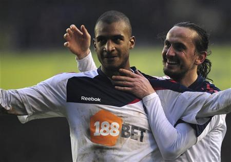 Bolton Wanderers' David Ngog (L) celebrates with teammate Tuncay Sanli after scoring a goal against Millwall during their English FA Cup fifth round soccer match at The Den in London February 18, 2012. REUTERS/Kieran Doherty