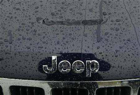 A wet Jeep logo and grill is shown at the Criswell Chrysler-Dodge-Jeep-Fiat-Ram truck dealership in Gaithersburg, Maryland October 2, 2012. REUTERS/Gary Cameron