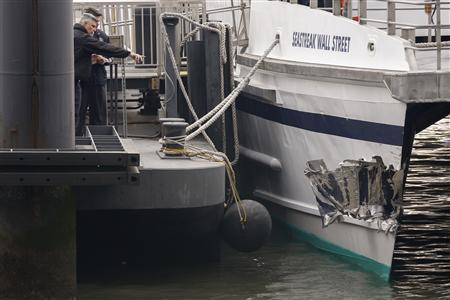 Investigators examine the damage to a commuter ferry that crashed during the morning rush in New York, January 9, 2013. REUTERS/Brendan McDermid