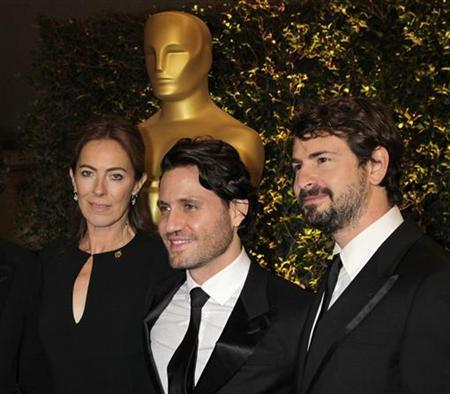Director Kathryn Bigelow, arrives with Venezuelan actor Edgar Ramirez (C) and screenwriter Mark Boal at the Academy of Motion Picture Arts & Sciences 4th annual Governors Awards in Hollywood December 1, 2012. REUTERS/Fred Prouser/Files