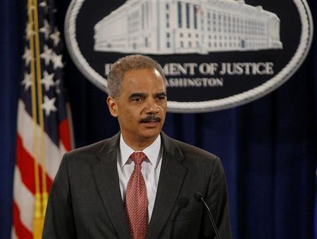 U.S. Attorney General Eric Holder announces enforcement actions against UBS Securities Japan Co. Ltd.investment bank at the Justice Department in Washington December 19, 2012. REUTERS/Gary Cameron (UNITED STATES - Tags: CRIME LAW BUSINESS)