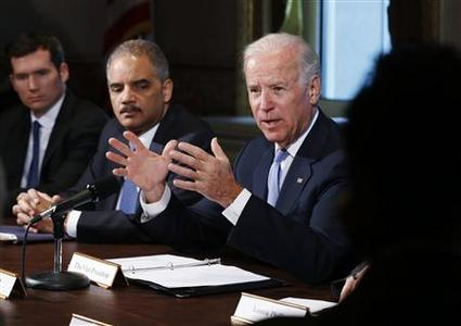 U.S. Vice President Joe Biden (R) speaks to representatives of gun safety and gun violence victims' groups in the Eisenhower Executive Office Building on the White House complex in Washington, January 9, 2013. President Barack Obama is ''determined to take action'' against gun violence and is weighing possible executive orders aimed preventing further attacks like last month's shooting massacre at a Connecticut elementary school, Biden said on Wednesday. Also pictured is U.S. Attorney General Eric Holder (2nd L). REUTERS/Larry Downing