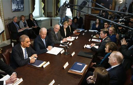 U.S. Vice President Joe Biden (2nd L) speaks to representatives of gun safety and gun violence victims' groups in the Eisenhower Executive Office Building on the White House complex in Washington, January 9, 2013. President Barack Obama is ''determined to take action'' against gun violence and is weighing possible executive orders aimed preventing further attacks like last month's shooting massacre at a Connecticut elementary school, Biden said on Wednesday. Also pictured is U.S. Attorney General Eric Holder (L). REUTERS/Larry Downing