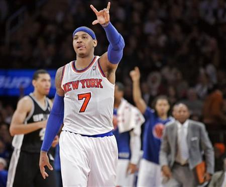 New York Knicks' forward Carmelo Anthony (7) celebrates a three-point shot against the San Antonio Spurs in the third quarter of their NBA basketball game at Madison Square Garden in New York, January 3, 2013. REUTERS/Ray Stubblebine