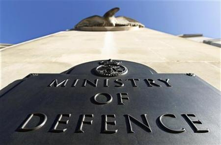 A plaque is seen on the Ministry of Defence building entrance in London, September 15, 2010. REUTERS/Suzanne Plunkett