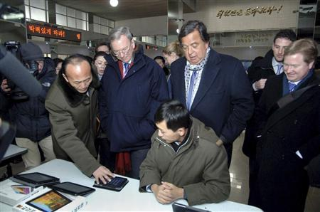 Former New Mexico Governor Bill Richardson (centre R) and Google Executive Chairman Eric Schmidt (centre L) visit the Korean Computer Center in Pyongyang January 9, 2013 in this picture released by the North Korea's KCNA news agency. REUTERS/KCNA