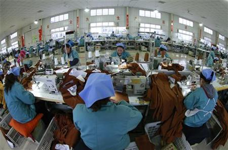 Employees work on products that will be exported to southeast Asia at a garment factory in Huaibei, Anhui province, December 17, 2012. REUTERS/Stringer/Files
