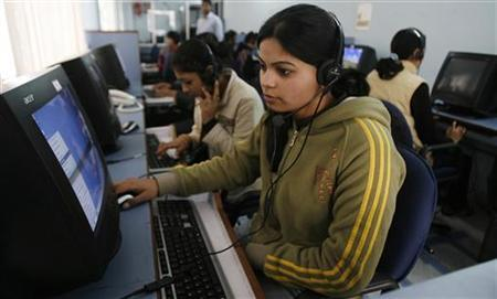 Employees at a call centre provide service support to customers in Siliguri February 2, 2008. REUTERS/Rupak De Chowdhuri/Files