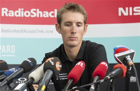 Andy Schleck looks down as he addresses a news conference in Luxembourg June 13, 2012. REUTERS/Jan Schwarz