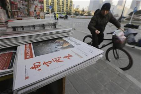 A stack of the Southern Weekly are left on display at a newsstand in Beijing, January 10, 2013. REUTERS/Jason Lee
