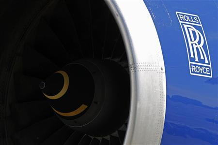 A Rolls-Royce aircraft engine of a British Airways (BA) Boeing 747 passenger aircraft is seen at Heathrow Airport in west London April 7, 2011. REUTERS/Stefan Wermuth