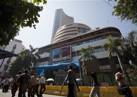 People walk outside the Mumbai Stock Exchange building February 10, 2011. REUTERS/Vivek Prakash/Files