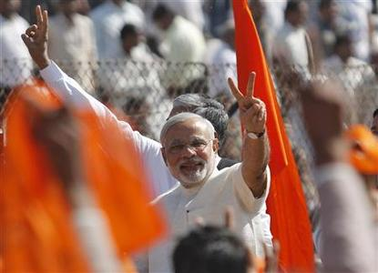 Narendra Modi, Chief Minister of India's western state of Gujarat, gestures after taking his oath as chief minister during a swearing-in ceremony in Ahmedabad December 26, 2012. REUTERS/Amit Dave/Files