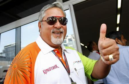 Vijay Mallya gives the thumb up at the end of the third practice session of the Italian F1 Grand Prix in Monza September 12, 2009. REUTERS/Max Rossi/Files