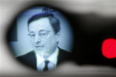 European Central Bank (ECB) President Mario Draghi is seen through the viewfinder of a TV camera during his monthly ECB news conference in Frankfurt December 6, 2012. REUTERS/Lisi Niesner