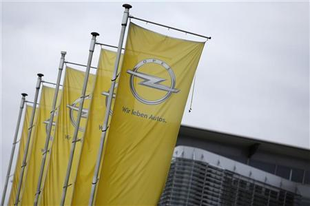 Flags with a logo of German car manufacturer Opel are pictured near the headquarters in Ruesselsheim November 12, 2012. REUTERS/Lisi Niesner