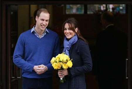 Britain's Prince William leaves the King Edward VII hospital with his wife Catherine, Duchess of Cambridge, London December 6, 2012. REUTERS/Andrew Winning/Files
