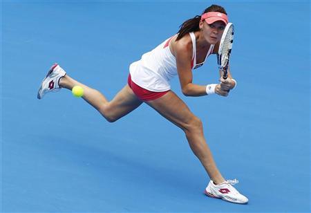 Agnieszka Radwanska of Poland hits a return to Kimiko Date-Krumm of Japan during their women's singles match at the Sydney International tennis tournament in Sydney January 8, 2013. REUTERS/Daniel Munoz
