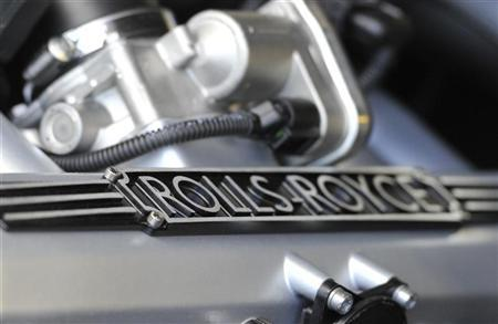 The Rolls-Royce logo is seen on an engine head at the Rolls-Royce plant where the Phantom and Ghost models are manufactured in Goodwood, near Chichester in south England May 10, 2011. REUTERS/Toby Melville