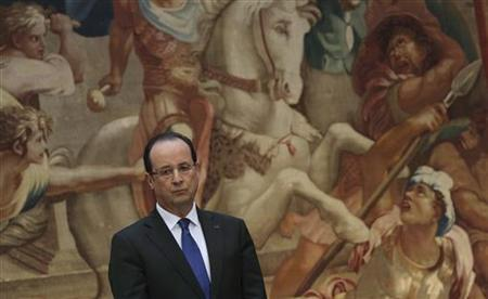 French President Francois Hollande listens to a New Years speech during a ceremony for civil servants and constitutional bodies at the Elysee Palace in Paris, January 8, 2013. REUTERS/Philippe Wojazer