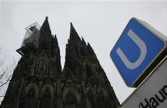 The sign of the underground station Dom/Hauptbahnhof is pictured in front of the Cologne Cathedral in Cologne, January 10, 2013. REUTERS/Wolfgang Rattay
