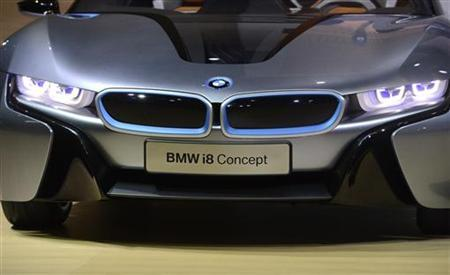 The BMW i8 concept car is displayed during a news conference at the 2012 Los Angeles Auto Show in Los Angeles, California November 28, 2012. REUTERS/Phil McCarten (UNITED STATES - Tags: TRANSPORT BUSINESS)