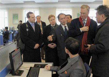 U.S. delegations including Google Executive Chairman Eric Schmidt (2nd R) look at a student using the Internet with desktop computers as he visits Kim Il-Sung University in Pyongyang, in this photo taken by Kyodo January 8, 2013. REUTERS/Kyodo