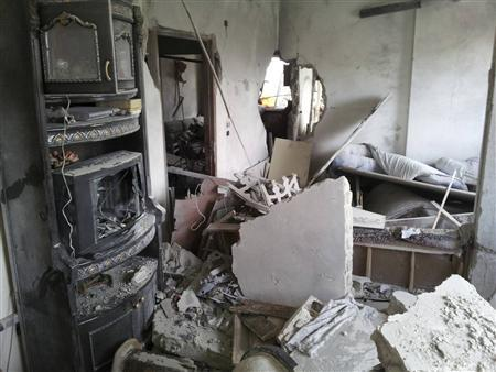 A view of a house damaged by what activists said were missiles fired by a Syrian Air Force fighter jet loyal to President Bashar al-Assad in Jubar, near Damascus, January 5, 2013 in this picture provided by Shaam News Network. Picture taken January 5, 2013. REUTERS/Abu Adel Al-Jubarani/Shaam News Network/Handout