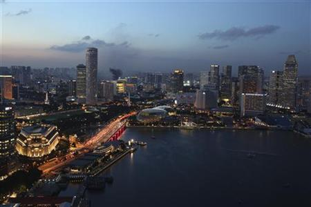 A view of the central business district (CBD) skyline at dusk in Singapore August 16, 2011. Prominent landmarks such as The Fullerton Hotel (L) and the Esplanade (C) are seen. REUTERS/Clarissa Cavalheiro