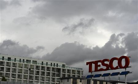 A Tesco store sign is seen in Kensington, west London October 3, 2012. REUTERS/Paul Hackett