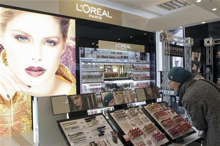 A woman looks at L'Oreal cosmetics in the shop in Riga April 13, 2012. REUTERS/Ints Kalnins