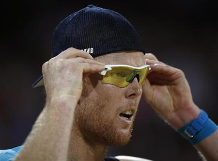 Germany's Jonas Reckermann adjusts his glasses during their men's beach volleyball gold medal match against Brazil's Emanuel and Alison at Horse Guards Parade during the London 2012 Olympic Games August 9, 2012. REUTERS/Marcelo Del Pozo