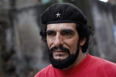 Humberto Lopez, known as ''El Che'', pauses while speaking to Reuters in Caracas January 8, 2013. REUTERS/Carlos Garcia Rawlins