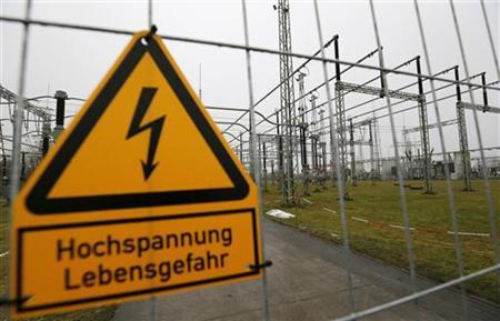 Parts of an electric power transformation substation are seen in Schwerin December 18, 2012. Sign reads ''High voltage - Danger to life''. REUTERS/Morris Mac Matzen (GERMANY - Tags: POLITICS ENERGY BUSINESS)