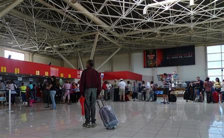 A traveller stands at the check-in lobby at Havana's Jose Marti International Airport October 16, 2012. REUTERS/Desmond Boylan