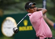Thongchai Jaidee of Thailand watches his shot from the 16th tee during the second round of the DP World Tour Championship at Jumeirah Golf Estates in Dubai November 23, 2012. REUTERS/Nikhil Monteiro