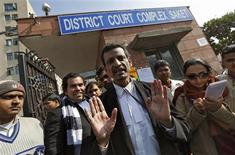 Manohar Lal Sharma (C), lawyer of one of the accused Mukesh Singh, speaks with the media outside a district court in New Delhi January 10, 2013. One of the five men charged with the gang rape and murder of an Indian student said police tortured him in custody and he and at least three of his co-defendants say they are innocent, lawyers said on Thursday. REUTERS/Adnan Abidi