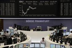Traders are pictured at their desks in front of the DAX board at the Frankfurt stock exchange January 10, 2013. REUTERS/Remote/Janine Eggert (GERMANY - Tags: BUSINESS)
