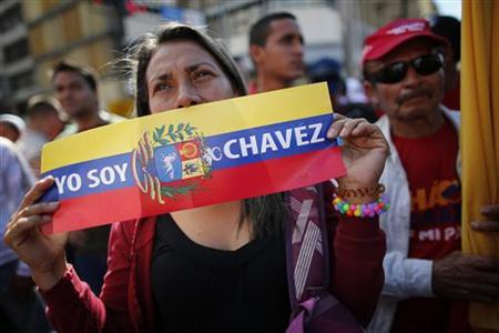 A supporter of Venezuelan President Hugo Chavez reacts as she attends a gathering outside Miraflores Palace in Caracas January 10, 2013. REUTERS/Jorge Silva