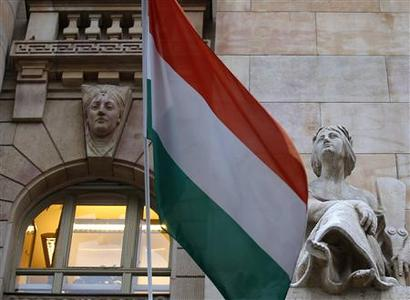 The Hungarian national flag flies on the building of the National Bank of Hungary in Budapest January 10, 2013. REUTERS/Laszlo Balogh