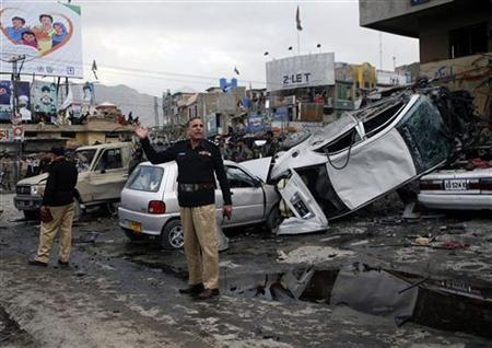 A police official gestures at the scene of a bomb explosion in Quetta January 10, 2013. REUTERS/Naseer Ahmed