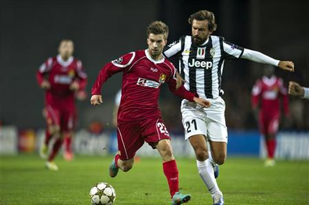 Andreas Laudrup of FC Nordsjaelland (L) fights for the ball with Andrea Pirlo of Juventus during the Champions League group E soccer match at Parken Stadium in Copenhagen October 23, 2012. REUTERS/Jens Noergaard Larsen/Scanpix Denmark