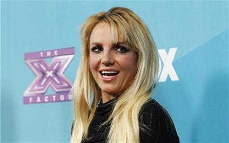 Judge Britney Spears poses at the party for the television series ''The X Factor'' finalists in Los Angeles, California November 5, 2012. REUTERS/Mario Anzuoni/Files