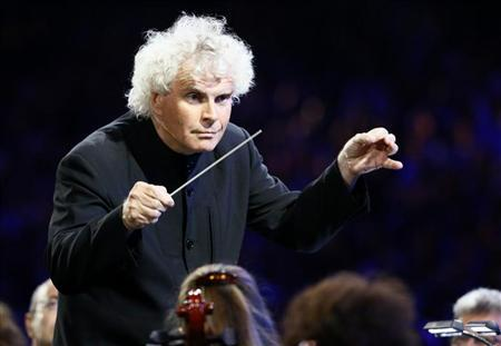 Conductor Simon Rattle takes part in the opening ceremony of the London 2012 Olympic Games at the Olympic Stadium July 27, 2012. REUTERS/Kai Pfaffenbach