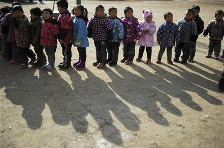 Students line up attending a sports class on the playground of a primary school in Dabie Mountain, Anhui province, December 19, 2012. REUTERS/Stringer/Files